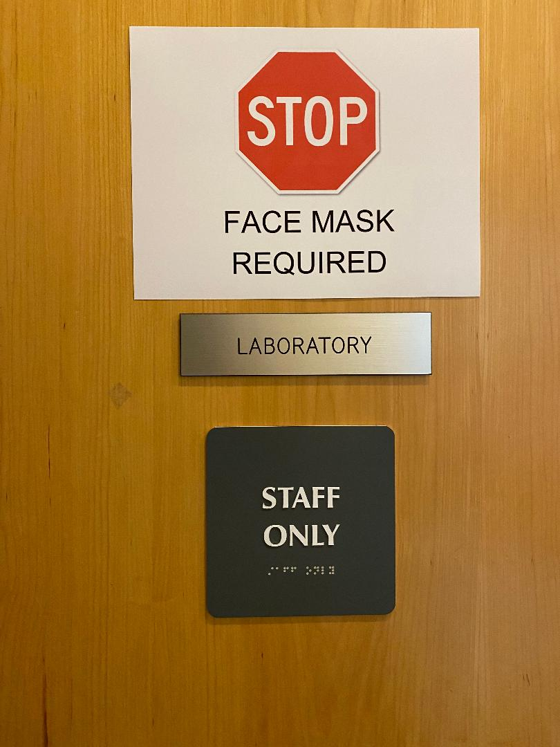 """""""Stop, Face Mask Required"""" notice on the door photo"""
